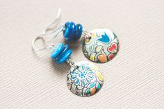 Hey, I found this really awesome Etsy listing at https://www.etsy.com/listing/203627629/recycled-tin-earrings-with-blue-beads