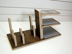 Charge phone & a tablet and organize your life in style with this wood docking station. Fits any smartphone and tablet or eReader on the market. - Integrated foam cord holder prevents the cord from slipping - Cork pads on bottom elevate base so cord can slip underneath - Fits phones and