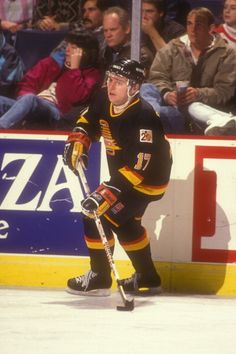 Vladimir Krutov of the Vancouver Canucks skates with the puck during a hockey game against the Washington Capitals on January 5 1990 at the USAir...