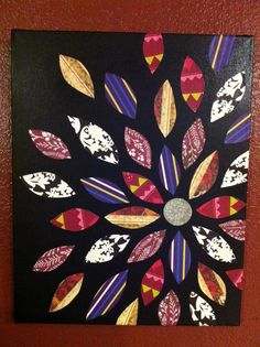 I stole this idea from another pinner - paint a canvas black, then mod podge various petal-shaped pieces of scrapbook paper to it! I think it came out pretty great :)
