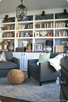 I like the built-in bookcases here and the color scheme with white and gray.