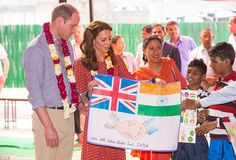 The Royal couple receive a drawing on their visit to a children's centre that supports homeless children at New Delhi railway station