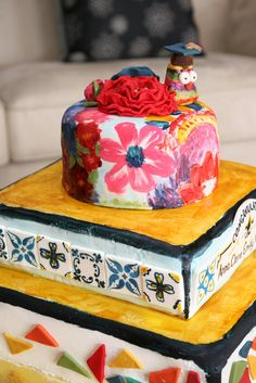 Graduation Cake decorated with spanish tiles, mexican paper flowers, mexican art, and mosaic inspiration, sweet kiera