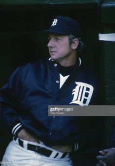 Outfielder Al Kaline of the Detroit Tigers leans against the wall of the dugout prior to a game in April, 1973 at Tiger Stadium in Detroit, Michigan. Detroit Tigers Baseball, Pittsburgh Steelers, Dallas Cowboys, Indianapolis Colts, Cincinnati Reds, Baseball Card Values, Baseball Cards, Detriot Tigers, Tiger Stadium
