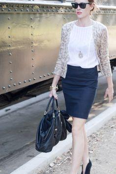 black skirt, white shirt, animal print cardigan, black shoes and a blacl bag. Very classic.