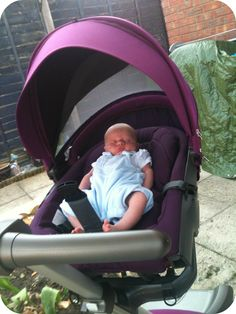 Chilling in his #stokke #xplory in the sun with ventilation in the hood.