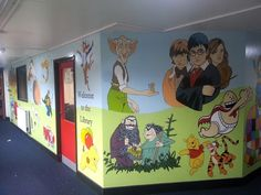 This large mural was painted on the interior walls surrounding this primary school library. It features a simple green and blue background so that we could spend lots of time adding many book characters from the pupils favorite books. This included The BFG, The Twits, Harry Potter, Captain underpants and Spot the Dog. This is a great way to make children excited about reading and encourage them to visit the library.