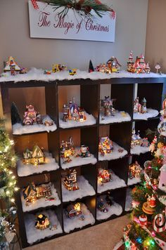 Village,cute way to display,would be even cuter if the cubicle was white
