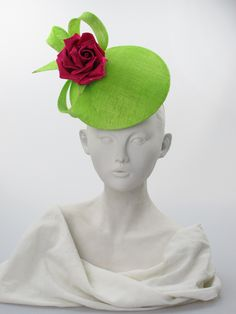 Perching hat | Philip Treacy | Lime green sinamay disc with crystal dotted fuschia silk rose on a wired hairband. Secured by a metal comb. Summer wear. Free size | Made in England