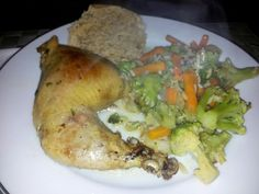Baked chicken with broccoli carrots and rice medley with an English muffin