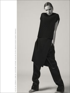 Cece Yost wears Top by JW ANDERSON. Skirt by ALEXANDRE VAUTHIER. Pants by CELINE. Shoes by MAISON MARTIN MARGIELA.