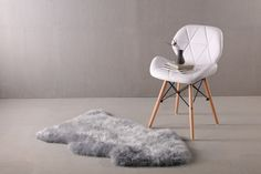 """Fibre by Auskin's new light grey sheepskin color PLATINUM. This color available in rugs and 20"""" cushions. Call today for more information. 888-528-7546"""