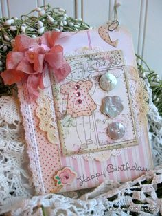 Love the vintage look on this card front using a little and girl edged doily