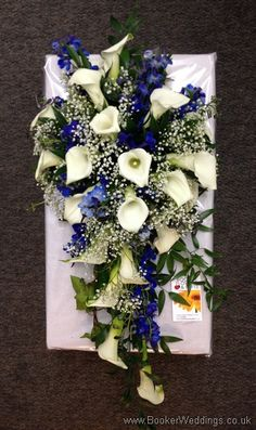 Bridal teardrop shower bouquet featuring white calla lillies, blue delphinium and gypsy grass  Wedding Flowers Liverpool, Merseyside, Bridal Florist, Booker Flowers and Gifts, Booker Weddings