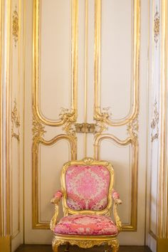 Pink rococo chair and gilded panneling........