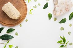 Natural loofah on wooden board with spa stone and spread leaves on white background #paid, , #Sponsored, #Paid, #board, #Natural, #loofah, #spa