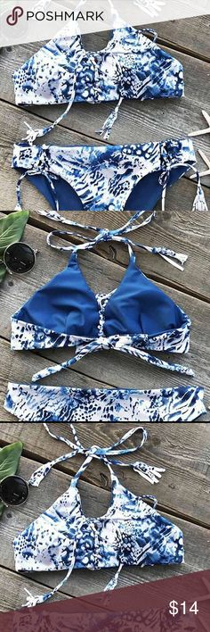 NEW Blue and white tassel tie Bikini Blue and white pretty pattern with lace up front top and tassels on each end. Lace up side bikini bottoms for easy adjusting! In my opinion, fits true to size! Size M CupShe Swim Bikinis