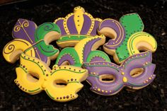 Mardi Gras Cookies, Mardi Gras Cookie Favors, Custom Cookies, Masquerade Party Cookies, Decorated Cookies, Masks by 4theloveofcookies on Etsy https://www.etsy.com/listing/170329462/mardi-gras-cookies-mardi-gras-cookie