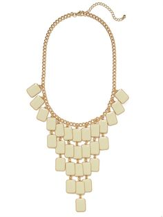 It doesnt get more dramatic than this chic statement necklace. It features a dynamic chandelier silhouette crafted from gorgeous tile-like gems.
