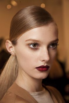 inspired by the '70s--think dark lips, spider lashes and sheer blush