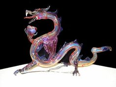 This snake dragon pipe is all genuine hand blown glass made with a combination of art and science thick wall glass tubing. It is 4 inches tall, 7 inches long, and 2 inches wide. The snake dragon can be fumed with a combination of colors or pastel colors. Glass Pipes And Bongs, Glass Bongs, Amethyst Crystal, Crystal Ball, Glass Crystal, Goblin, Snake Dragon, Weed Pipes, Beautiful Dragon