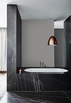 Soft and serene, cocooning and sumptuous; warm greys create a flexible backdrop for stronger more contrasting colours. Light or dark, warm greys work seamlessly in open-plan spaces and exteriors, pairing well with natural materials and pastel accents. Dulux colour: Boulder Beach #Dulux #houseenvy #interiordesign #design #homedecor #style #bathroom #inspiration #interiorstyling #homedecoration #homestyle