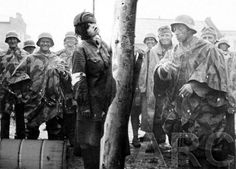 Photo Manipulated, German soldiers laughing after hanging a Soviet nurse.