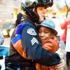 Police officer and young demonstrator share hug during Ferguson rally in Portland