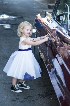 Adorable flower girl Chucks.