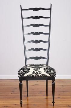 """Superlegerra Chair - $300.00 - Vintage lightweight ladderback chair in the style of Gio Ponti. Upholstered seat. Painted black frame.  • very good vintage condition  • 51"""" high  • 18' high to top of seat  • seat is 18"""" wide in front tapers to 12"""" in back"""