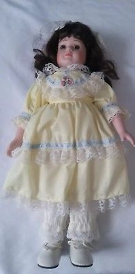 """vintage porcelain doll with yellow dress 15"""""""