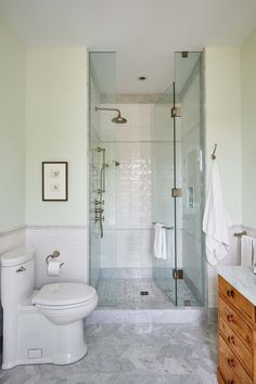 White subway tile and glass Standup Shower in elegant marble bathroom by Sarah Richardson Cozy Bathroom, White Bathroom, Bathroom Interior, Small Bathroom, Bathroom Ideas, Bathroom Designs, Restroom Ideas, Marble Bathrooms, Guest Bathrooms