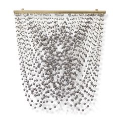 Metal frame with hand-wrapped natural jute rope accented with hanging wood beads in a greyish plum finish. Includes metal metal hangers for mounting.