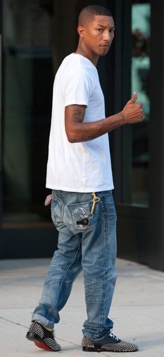 Pharell Williams spotted wearing a pair of Rollerboy Spikes slip-ons from Christian Louboutin with a pair of Billionaire Boys Club jeans!  Spare the hate, the man has been voted International best dressed man of 2010 by esquire magazine.   That's some serious fashion sense.