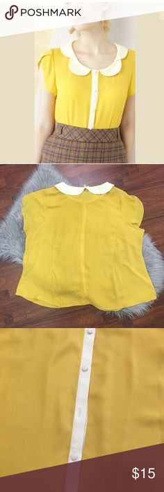 MODCLOTH Peter Pan Collar yellow Blouse Details: Good Preowned Condition- Gently worn  *DAMAGE* MISSING BUTTON- EXTRA BUTTON IS ATTACHED TO INNER MATERIAL LABEL No discoloration No Flaws or Defects- Aside from what is mentioned above regarding the missing button Peter pan collar Modcloth Tops Blouses