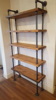 Georgeous industrial style shelving unit that will look great in any room. Made from real 3/4 pipe and solid distressed stained wood shelving. Measurements: 74 tall x 36 wide x 11.25 deep. 11.25 space between each shelf. 5 shelves total. Attaches to the wall on the top, feet