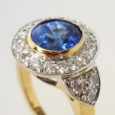 Sapphire and diamond cluster ring, with diamonds set in the shoulders