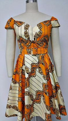 Dutch Wax Fitted Waist Dress with Cross Over Sweetheart Neckline. This is a fully lined Dutch wax fitted waistline dress with cross over sweetheart neckline. African Dresses For Women, African Print Dresses, African Attire, African Wear, African Fashion Dresses, African Women, Nigerian Fashion, Ghanaian Fashion, African Prints