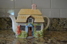Seasons Teapot  SUMMER Cottage Tea Pot English by Pink Pig Emporium This is a wonderful tea pot that is part of an English Country Cottage Seasonal Series. It measures approx. 7 inches high by 8 long and is in great condition. It would make a great addition to any collection or kitchen, and brings the spirit of the season into the home. This is a charming piece that will look great for years to come!