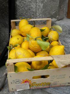 Fresh lemons outside a little market in Italy....  ~Love lemons!