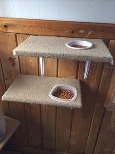 Cat food perch made out of an old cat scratching tree post. I cut holes in it big enough for the food dish to slide in but not slide through & bought a few shelf brackets & attached them & hung them on the wall! Now the cats can eat up where they like to be & the dogs can't eat their food