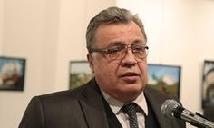 The Russian ambassador to Turkey, Andrei Karlov, speaks at a gallery in Ankara before he was shot.