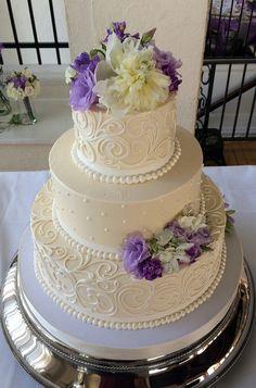 3 tier buttercream wedding cake with fresh flowers