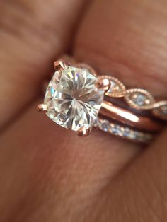 This is exactly what I want except a white gold engagement ring (round or cushion cut, 4 prong, at least 1-1.5ct)! Rose gold separate bands on both sides of the engagement ring. One as a wedding band and one as a promise ring.