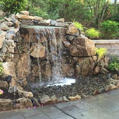 Having a sloped yard is the perfect opportunity to add a water feature and enjoy the movement in your outdoor space Indoor Waterfall, Garden Waterfall, Waterfall Fountain, Backyard Water Feature, Ponds Backyard, Water Falls Backyard, Fish Pond Gardens, Water Gardens, Outdoor Waterfalls
