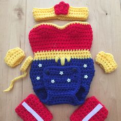 Wonder Woman crocheted onesie handmade by me Inspired by https://www.etsy.com/listing/238973805/wonder-woman-baby-crochet-prop-costume Etsy shop.