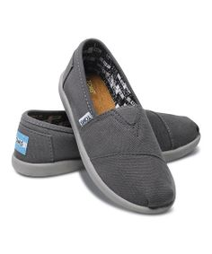 The original TOMS shoe that started it all. Constructed like the traditional Argentinian alpargata, this slip-on pair boasts the classic TOMS toe-stitch, elastic V goring for easy on and off, and a durable, ready-for-walking sole. And with the purchase every pair of TOMS shoes, another pair is donated to a child in need somewhere in the world.Size note: TOMS run true to size. I...