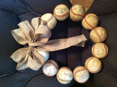 This is my version of the baseball wreath I have seen many times here. This is my Dad's Fathers Day gift. He coached for over 20 years so I found some of his most memorable players & had them each sign a ball to be added to the wreath & used burlap ribbon to compliment its old look.