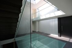 exterior, Modern Glass Interior As Transparent Floor And Simple Window Design: Stunning Modern Glass House with Beautiful Garden by LVS Architecture + JC NAME Arquitectos