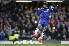 Eden Hazard jumps in celebration after scoring the opener  for the Blues at Stamford Bridge against the Potters